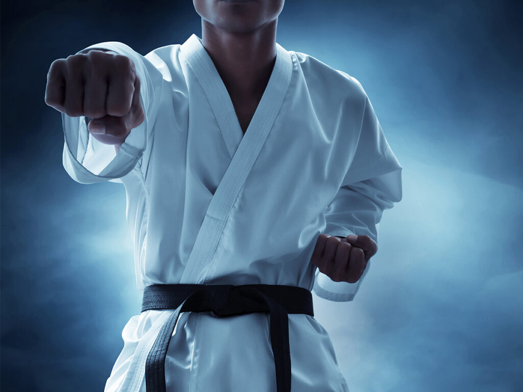A martial artist holding a fist out in front of him.
