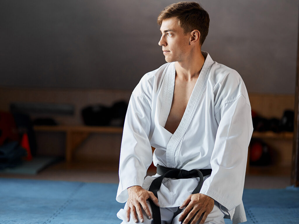 A martial artist resting, looking in the distance