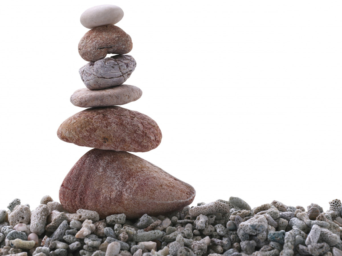A stack of five riverstones in decreasing size balanced in one tall stack.