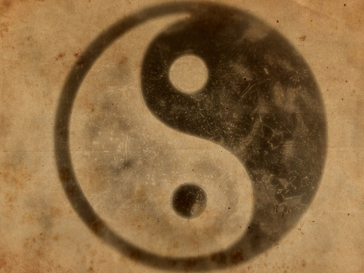 The symbol for a yin and yang — a circle with one half that's black and one half that's white.